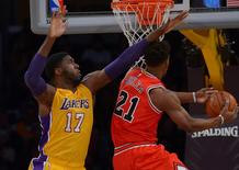 Jan 28, 2016; Los Angeles, CA, USA; Los Angeles Lakers center Roy Hibbert (17) defends a shot by Chicago Bulls guard Jimmy Butler (21) in the first quarter at Staples Center. Mandatory Credit: Jayne Kamin-Oncea-USA TODAY Sports