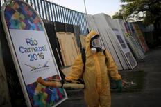 "A municipal worker stands next to a banner that reads, ""Rio Carnival 2016"" before spraying insecticide at Sambodrome in Rio de Janeiro, Brazil, January 26, 2016. REUTERS/Pilar Olivares"