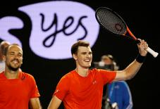 Britain's Jamie Murray (R) and Brazil's Bruno Soares celebrate after winning their doubles final match at the Australian Open tennis tournament at Melbourne Park, Australia, January 31, 2016. REUTERS/Issei Kato