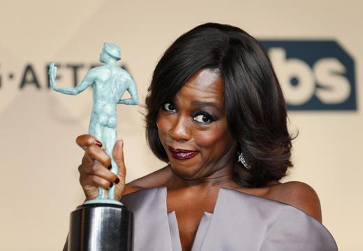 Viola Davis holds the award for Outstanding Performance by a Female Actor in a Drama Series for her role in