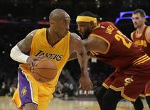 Jan 15, 2015; Los Angeles, CA, USA; Los Angeles Lakers guard Kobe Bryant (24) drives to the basket against Cleveland Cavaliers forward LeBron James (23) in the second half of the NBA game at Staples Center. Mandatory Credit: Richard Mackson-USA TODAY Sports