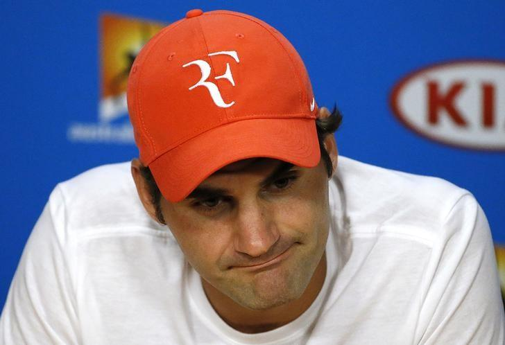 Switzerland's Roger Federer reacts during a news conference after losing his semi-final match against Serbia's Novak Djokovic at the Australian Open tennis tournament at Melbourne Park, Australia, January 28, 2016. REUTERS/Issei Kato