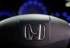 The logo of Honda Motor Co is seen on a steering wheel of a car at the company's showroom in Tokyo April 26, 2013.  REUTERS/Yuya Shino