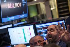 Specialist trader Peter Giacchi (R) shouts out a price for Brixmor Property Group Inc. during the company's IPO on the floor of the New York Stock Exchange, in New York October 30, 2013. REUTERS/Brendan McDermid