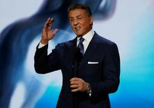 """Actor Sylvester Stallone introduces a clip from the nominated film """"Creed"""" at the 47th NAACP Image Awards in Pasadena, California February 5, 2016.  REUTERS/Mario Anzuoni"""