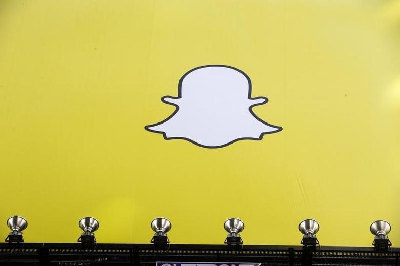 A billboard displays the logo of Snapchat above Times Square in New York March 12, 2015. REUTERS/Lucas Jackson/Files