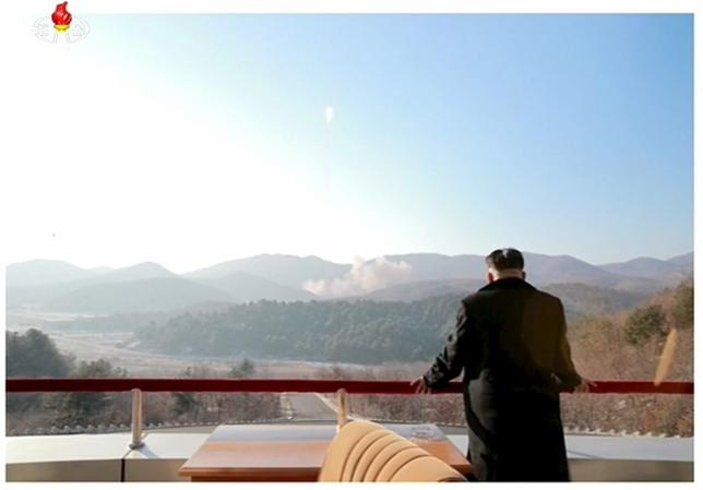 North Korean leader Kim Jong Un watches a long range rocket launched into the air in this still image taken from KRT footage and released by Yonhap on February 7, 2016.  REUTERS/Yonhap