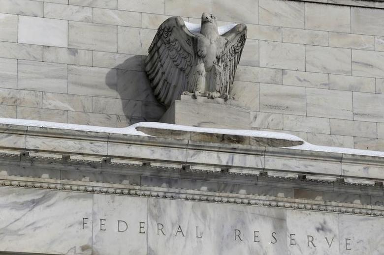 Snow rests on the eagle statue atop the U.S. Federal Reserve in Washington January 26, 2016. REUTERS/Jonathan Ernst