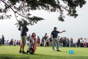 Pebble Beach, CA, USA; Phil Mickelson (right) talks to caddie Jim Mackay (left) on the 14th tee box during the third round of the AT&T Pebble Beach National Pro-Am at Pebble Beach Golf Links. Mandatory Credit: Kyle Terada-USA TODAY Sports