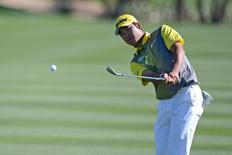 Feb 7, 2016; Scottsdale, AZ, USA; Hideki Matsuyama plays a shot on the 13th hole during the final round of the Waste Management Phoenix Open golf tournament at TPC Scottsdale. Mandatory Credit: Joe Camporeale-USA TODAY Sports