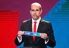 "Sergio Jadue, president of Chile's Football Federation, holds up a piece of paper with the word ""Chile"" on it during the official draw for the 2015 edition of the Copa America soccer tournament in Vina del Mar, in this November 24, 2014 file photo. REUTERS/Rodrigo Garrido/Files"