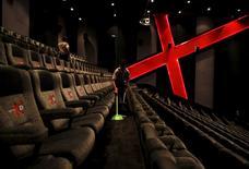 An employee at a Cinemaxx theatre cleans up between screenings in Lippo Karawaci, near Jakarta, Indonesia February 17, 2016. REUTERS/Darren Whiteside