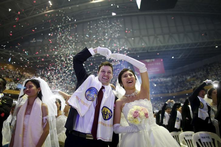 A Newlywed Celebrates During M Wedding Ceremony Of The Unification Church At Cheongshim Peace World Centre In Gapyeong South Korea