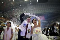 A newlywed couple celebrates during a mass wedding ceremony of the Unification Church at Cheongshim Peace World Centre in Gapyeong, South Korea, February 20, 2016.  REUTERS/Kim Hong-Ji