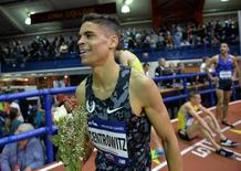 Feb 20, 2016; New York, NY, USA; Matthew Centrowitz (USA) takes a victory lap after winning the Wanamaker Mile in 3:50.63 during the 109th Millrose Games at The Armory. Mandatory Credit: Kirby Lee-USA TODAY Sports