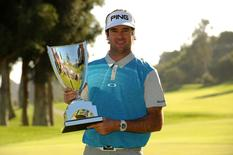February 21, 2016; Pacific Palisades, CA, USA; Bubba Watson poses with the winners trophy following his victory of the Northern Trust Open golf tournament at Riviera Country Club. Mandatory Credit: Gary A. Vasquez-USA TODAY Sports