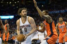 Feb 21, 2016; Oklahoma City, OK, USA; Cleveland Cavaliers forward Kevin Love (0) prepares to shoot the ball as Oklahoma City Thunder forward Kevin Durant (35) defends during the first quarter at Chesapeake Energy Arena. Mandatory Credit: Mark D. Smith-USA TODAY Sports
