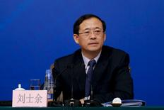 People's Bank of China Vice Chairman Liu Shiyu attends a news conference in Beijng, China, March 13, 2013. REUTERS/Stringer