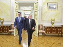 Russian President Vladimir Putin (R) and Syrian President Bashar al-Assad enter a hall during a meeting at the Kremlin in Moscow, Russia, October 20, 2015. Assad made a surprise visit to Moscow on Tuesday evening to thank Putin for launching air strikes against Islamist militants in Syria. Picture taken October 20, 2015. REUTERS/Alexei Druzhinin/RIA Novosti/Kremlin ATTENTION EDITORS - THIS IMAGE HAS BEEN SUPPLIED BY A THIRD PARTY. IT IS DISTRIBUTED, EXACTLY AS RECEIVED BY REUTERS, AS A SERVICE TO CLIENTS.   - RTS5E2Z