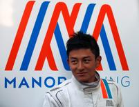 Manor Racing Formula One driver Rio Haryanto of Indonesia stands outside his team's garage after the third testing session ahead the upcoming season at the Circuit Barcelona-Catalunya in Montmelo, Spain, February 24, 2016. REUTERS/Sergio Perez