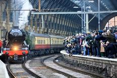 People watch from a railway platform as the Flying Scotsman steam engine prepares to leave Kings Cross station in London, February 25, 2016.   REUTERS/Paul Hackett