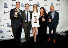 """(L-R) Producers Michael Sugar, director Tom McCarthy, Blye Pagon Faust, Nicole Rocklin and Steve Golin pose backstage with their award for Best Feature for the film """"Spotlight"""" during the 31st Independent Spirit Awards in Santa Monica, California February 27, 2016.  REUTERS/Danny Moloshok"""