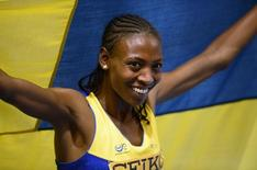 Sweden's Abeba Aregawi celebrates after winning gold in the women's 1500m final at the world indoor athletics championships at the ERGO Arena in Sopot March 8, 2014.                                     REUTERS/Dylan Martinez