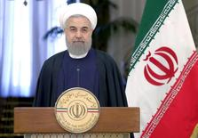 Iranian President Hassan Rouhani attend a news conference with Swiss President Johann Schneider-Ammann in Tehran February 27, 2016.REUTERS/Raheb Homavandi/TIMA