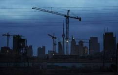 Construction cranes being used to build condominium buildings are seen along the skyline in Toronto in this file photo dated December 6, 2012. REUTERS/Mark Blinch