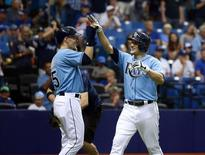 Oct 4, 2015; St. Petersburg, FL, USA; Tampa Bay Rays left fielder Mikie Mahtook (27) is congratulated by Tampa Bay Rays left fielder Brandon Guyer (5) as he hits a 2-run home run during the first inning against the Toronto Blue Jays at Tropicana Field. Mandatory Credit: Kim Klement-USA TODAY Sports