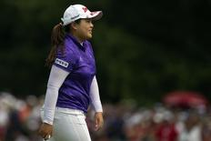 Park In-bee of South Korea celebrates her birdie on the 18th hole during the final round at the LPGA Canadian Women's Open golf tournament in Coquitlam, British Columbia in this August 26, 2012 file photo. REUTERS/Ben Nelms