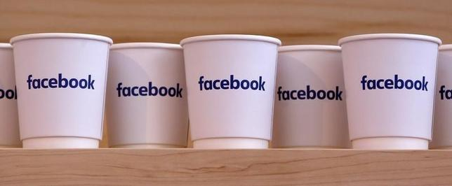 Cups with the Facebook logo are pictured at the new Facebook Innovation Hub during a preview media tour in Berlin, Germany, February 24, 2016. REUTERS/Fabrizio Bensch