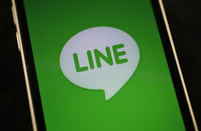 The logo of free messaging app Line is pictured on a smartphone in this photo illustration taken in Tokyo in this September 23, 2014 file photo. REUTERS/Toru Hanai