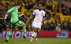 Nov 8, 2015; Columbus, OH, USA; Columbus Crew SC goalkeeper Steve Clark (1) clears the ball away from an attacking Montreal Impact forward Didier Drogba (11) during the first half of the game at MAPFRE Stadium. Columbus beat Montreal in extra time 4-3 on aggregate.Mandatory Credit: Trevor Ruszkowski-USA TODAY Sports