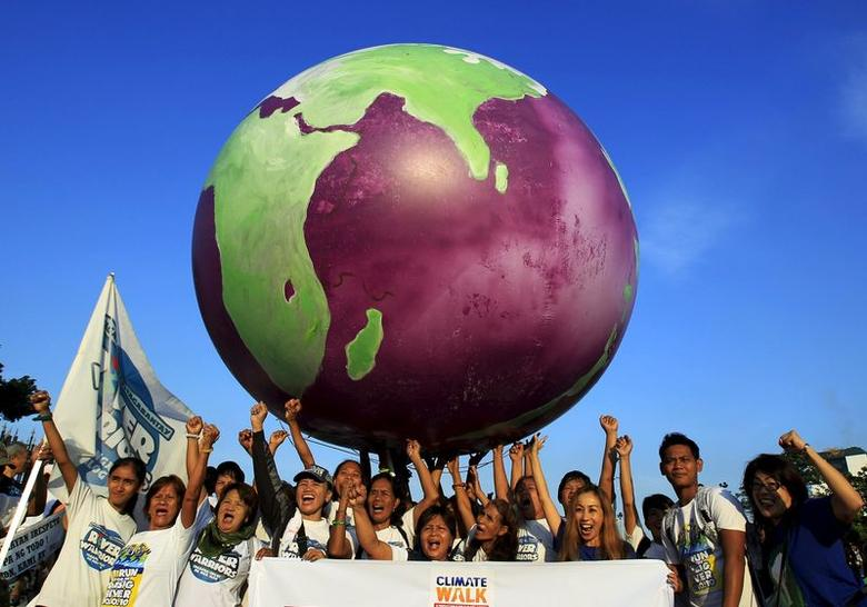 Environmental advocates carry over their heads a giant purple globe, which participants say represents their unhappiness towards genetically modified organism (GMO) products, in Manila in this October 2, 2014 file photo.  REUTERS/Romeo Ranoco/Files