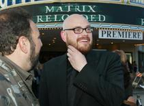 """Andy Wachowski (R), the co-director of the new film """"The Matrix Reloaded"""" talks with the film's producer Joel Silver (L) at the film's premiere in Los Angeles, California in this May 7, 2003 file photo. """"The Matrix"""" filmmaker Lilly Wachowski, formerly known as Andy, came out as a transgender woman on March 8, 2016 in a candid post entitled """"Sex change shocker - Wachowski brothers now sisters!!!,"""" four years after her sister Lana Wachowski revealed she was a transgender woman.     REUTERS/Fred Prouser/Files"""