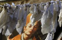 White sheets hang from a rope to protest against the decision of the Italian government to re-found the deputation of San Gennaro in Naples, Italy.  REUTERS/Ciro De Luca