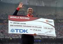 Aug 30, 2015; Beijing, China; Ashton Eaton (USA) poses with the gold medal and $100,000 check after winning the decathlon with a world record 9,045 points during the IAAF World Championships in Athletics at National Stadium. Mandatory Credit: Kirby Lee-USA TODAY Sports