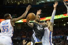 Feb 27, 2016; Oklahoma City, OK, USA; Golden State Warriors forward Andre Iguodala (9) drives to the basket in front of Oklahoma City Thunder center Enes Kanter (11) and forward Kevin Durant (35) during the second quarter at Chesapeake Energy Arena. Mandatory Credit: Mark D. Smith-USA TODAY Sports