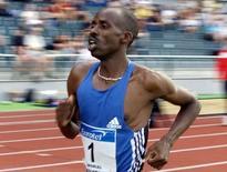 """Noah Ngeny of Kenya runs in the men's 1500 meters at the """"Memorial of Josef Odlozil"""" track and field meeting in Prague on June 17, 2002. REUTERS/Petr Josek/Files"""