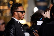 Formula One driver Lewis Hamilton attends the Stella McCartney Fall/Winter 2016/2017 women's ready-to-wear collection show in Paris, France, March 7, 2016. REUTERS/Benoit Tessier