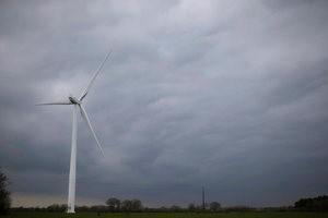 A motionlsess wind turbine is seen in a field in Bourgneuf-en-Retz, France, March 10, 2016. REUTERS/Stephane Mahe