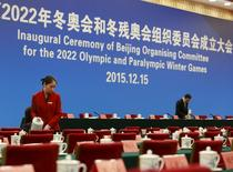 A staff prepares documents on a desk before the inaugural ceremony of Beijing organizing committee for the 2022 Olympic and Paralympic winter games at Great Hall of the People in Beijing, China December 15, 2015. REUTERS/Kim Kyung-Hoon