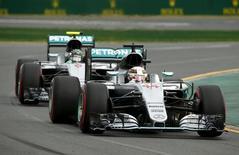Formula One -  Australia Grand Prix - Melbourne, Australia - 19/03/16 - Mercedes F1 driver Lewis Hamilton leads team mate Nico Rosberg during qualifying at the Australian Formula One Grand Prix in Melbourne.   REUTERS/Jason Reed
