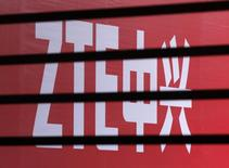 The company logo of ZTE is seen through a wooden fence on a glass door during the company's 15th anniversary celebration in Beijing April 18, 2013. REUTERS/Barry Huang