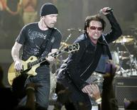 "Lead guitar player The Edge (L) and singer Bono of the Irish rock group U2 kick off the band's world tour ""Vertigo"" with their opening show in San Diego, California March 28, 2005."