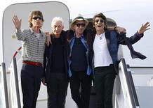 Mick Jagger, Charlie Watts, Keith Richards and Ronnie Wood of the Rolling Stones stand together after landing in Havana. REUTERS/Ivan Alvarado