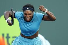 Mar 26, 2016; Key Biscayne, FL, USA; Serena Williams reacts after winning a point against Zarina Diyas (not pictured) during day five of the Miami Open at Crandon Park Tennis Center. Williams won 7-5, 6-3. Mandatory Credit: Geoff Burke-USA TODAY Sports
