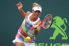 Mar 27, 2016; Key Biscayne, FL, USA; Angelique Kerber hits a forehand against Kiki Bertens (not pictured) during day six of the Miami Open at Crandon Park Tennis Center. Ferber won 1-6, 6-2, 3-0(ret.). Mandatory Credit: Geoff Burke-USA TODAY Sports