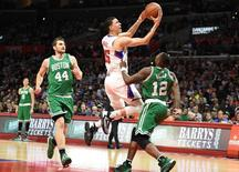 Mar 28, 2016; Los Angeles, CA, USA; Los Angeles Clippers guard Austin Rivers (25) shoots between Boston Celtics guard Terry Rozier (12) and center Tyler Zeller (44) in the first half during the NBA game at the Staples Center. Richard Mackson-USA TODAY Sports